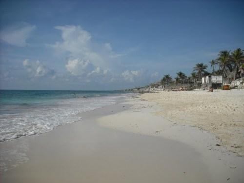 The beach in Tulum, with a hotel or two off to the side
